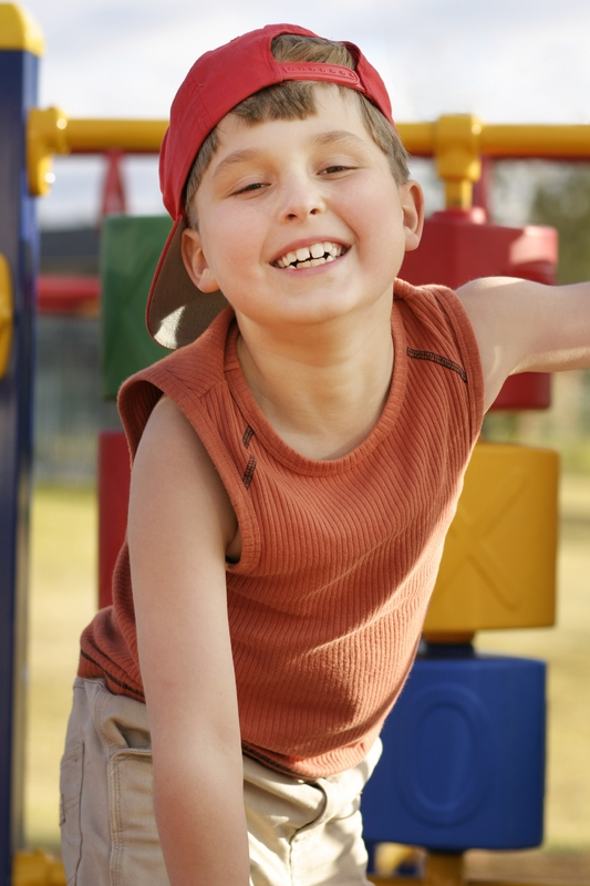 Boy playing on play equipment